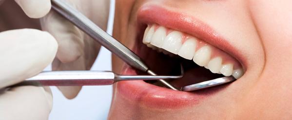 Чем опасна киста в десне над зубом